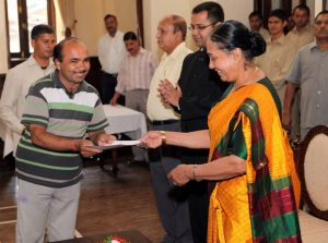 Taking Prize for Photography from Governer of Uttarakhand